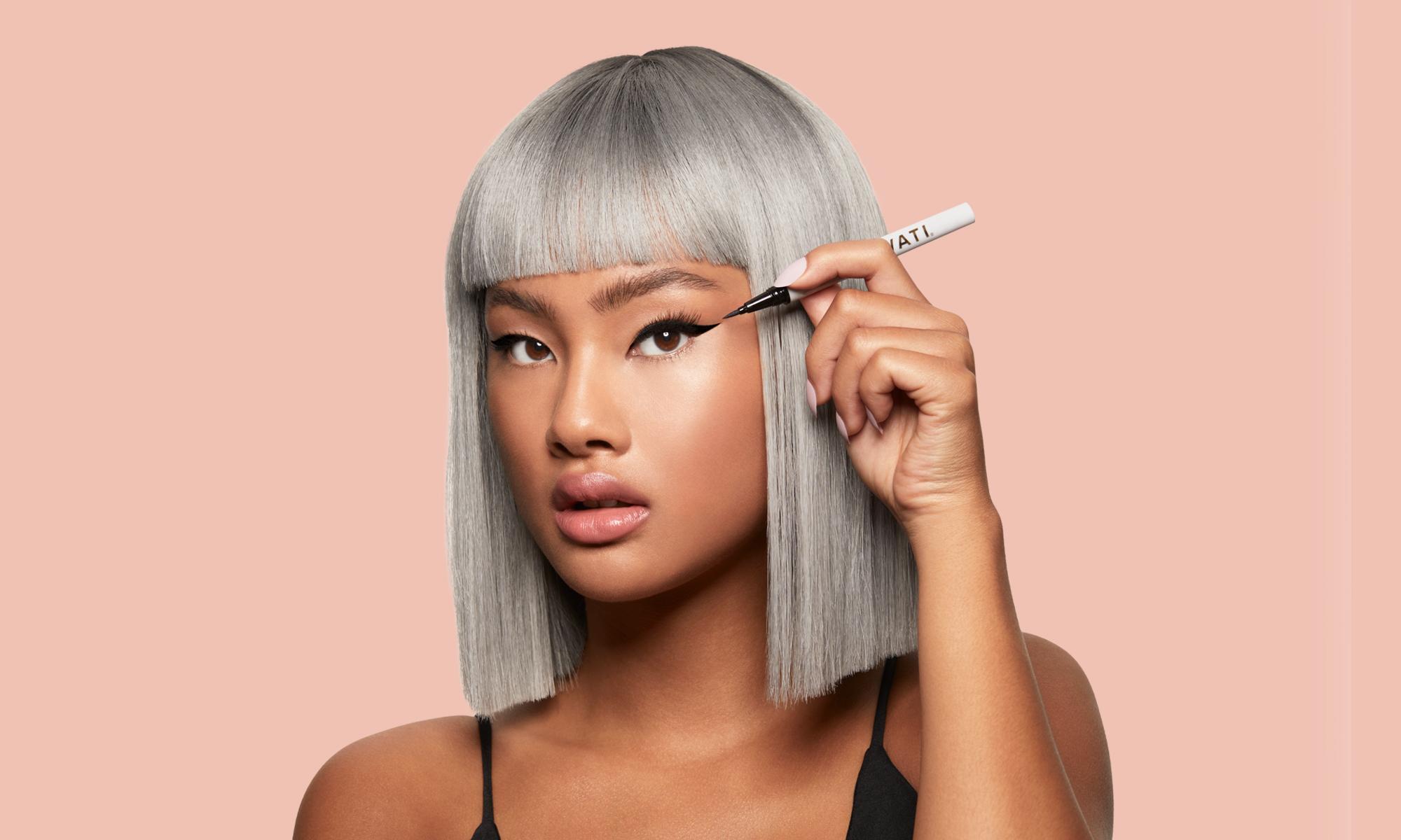 Asian model applying VANTA Eyeliner from SWATI Classic Kit