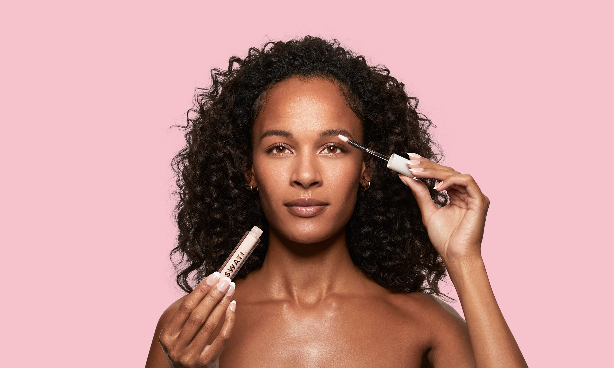 SWATI Tourmaline - Lash & brow boosting serum on tanned skin model